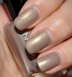 Zoya Jules - Sparkling neutral light taupe with gold, silver and champagne metallic shimmer.