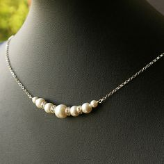 Grace: Sterling Silver Swarovski Pearl Necklace, Simple Pearl & Crystal Necklace, Bridal Party Jewelry, Bridesmaids Necklace. $29.00, via Etsy.