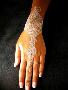 I really don't get into pinning wedding stuff . . . but I'm digging this white henna!