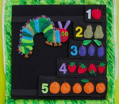 Very Hungry Caterpillar activity board. Very cute, and she made it with a travel case.  I think the only change I would make is to size the fruit and caterpillar so that the caterpillar could go through a hole in the fruit.