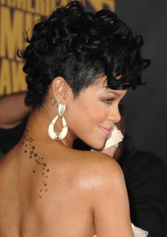 Rihanna Curly Fohawk Hairstyle Side View - Rihanna's Short Haircuts: Best Styles Over the Years