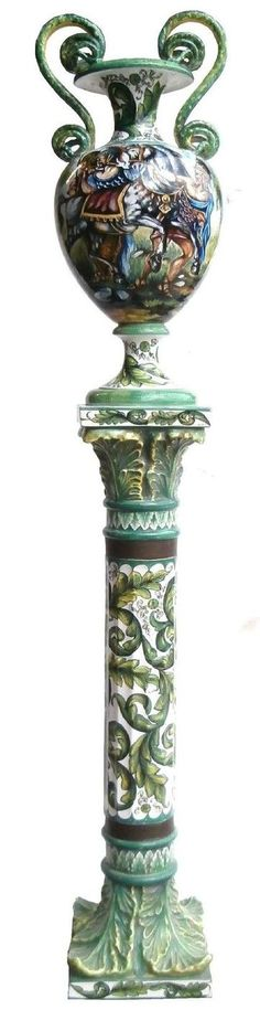 AN ITALIAN MAJOLICA ISTORIATO TWO-HANDLED HAND-PAINTED CERAMIC URN ON PEDESTAL.