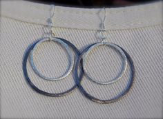 two toned brushed silver earrings.