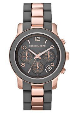 grey and rose gold watch by Michael Kors