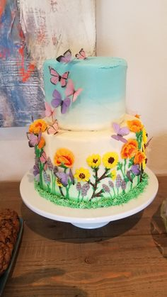 Two tiered spring meadow cake with buttercream flowers and wafer paper butterflies. Wildflowers are California poppies, California sunflowers, and lupine. Bug Birthday Cakes, Garden Birthday Cake, Image Birthday Cake, Butterfly Birthday Cakes, Elegant Birthday Cakes, Birthday Cake With Flowers, Beautiful Birthday Cakes, Butterfly Cakes, Butterflies