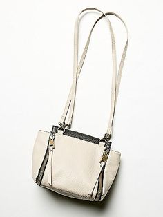 Mylan Vegan Crossbody | Designed with edgy hardware and zipper detailing, this textured vegan leather crossbody is streamlined and chic with a touch of attitude. Features removable shoulder straps, zip closure, and interior compartments. The perfect versatile bag in a size that's not too big.  *By PF + Free People