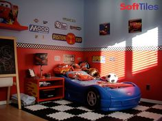 Cars theme with red walls, decals and b&w foam tiles.