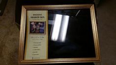 Gold colored shadow box still in package