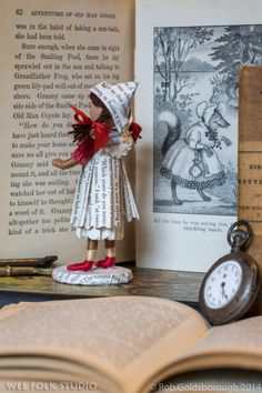 Salley Mavor's doll dressed in book pages