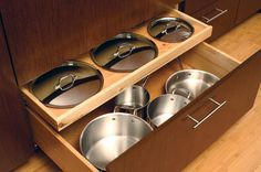 4. Stash pot lids in a rollout. Pot lids can be the bane of any home chef's existence, jamming drawers and preventing pots from stacking pro...
