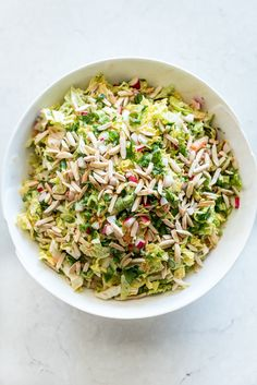 A fun twist on a classic slaw, This Crunchy Napa Slaw is made with napa cabbage, radishes, cilantro, and an Asian inspired dressing. It's the perfect summer potluck! We haven't been gre… Napa Cabbage Recipes, Napa Cabbage Slaw, Napa Salad, Vegetarian Recipes, Healthy Recipes, Delicious Recipes, Yummy Food, Slaw Recipes, Bread Recipes