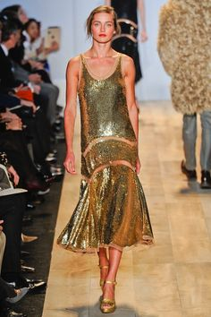"""Michael Kors. """"Simple lines but oh so sophisticated, understated (despite being in gold lamé) chic! There's an air of 1920's glamour about it."""" ~ Epi"""