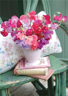 Old painted stool, pretty embroidered cushions, vintage books and a vase of gorgeous sweet peas; perfect!