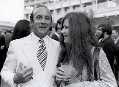 "Clive Davis with Janis Joplin at a party celebrating Joplin's record deal in 1968. Davis told Rolling Stone of the first time he saw Big Brother and the Holding Company at the Monterey Pop Festival, ""Joplin was mesmerizing, like a white tornado."""
