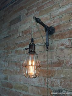 *******3 X Iron Hardware   We brought simplicity and ease of installation to this industrial style wall sconce!  This clever design lets you