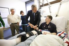 Trump is president not to visit troops at Christmas since Pres. Bush shakes hands with U. Kyle Stipp after presenting him with two Purple Heart medals at Walter Reed Army Medical Center on Dec. NBC News, Military Personnel, Us Military, Military Quotes, Military Humor, Purple Heart Medal, Walter Reed, Bush Family, Past Presidents, Home Of The Brave