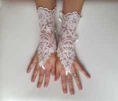 Elegant ivory lace bridal gloves Wanting to feel yourself unique for brides Each custom-made suitable I am sending the post office. arrival time 2 - 3 week Thank you for visiting my shop GlovesByJana Wedding Dress Sash, Wedding Gloves, Ivory Wedding, Wedding Dresses, Lace Gloves, Fingerless Gloves, Handmade Wedding, Bridal Lace, Bride