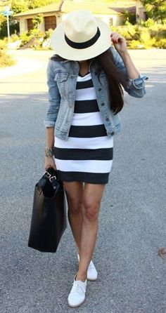 how to style a denim jacket : striped dress + bag + hat + sneakers