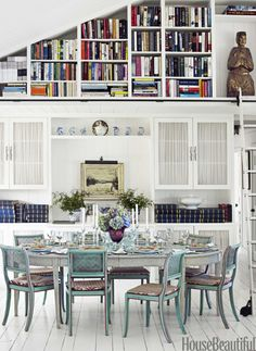 I love the Swedish grey painted table and fabulous blue chairs in this House Beautiful Dining Room