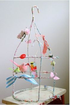 coat hanger bird cage? by vivian-what else might you keep in a cage?