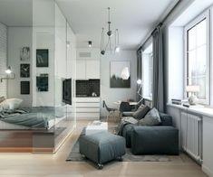 Este 32 metros quadrados (344 pés quadrados) apartamento usa paredes de vidro interiores para criar um quarto que não fazer a casa se sentir qualquer menor.