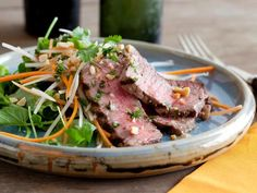 When Bobby makes Grilled Steak and Papaya Salad, he marinates his steak in a mixture of spicy Thai chiles, soy sauce, lime juice and honey. Splurge for filet mignon, or use a less expensive but still lean sirloin steak.