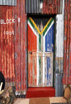 EMOYA ESTATE: The front door of one of the shacks at Shanty Town in Bloemfontein, South Africa. Door Entryway, Entry Doors, Entrance, Old Doors, Windows And Doors, Knobs And Knockers, Door Gate, Painted Doors, Metal Roof