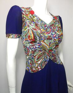 1940s dress with paisley jersey rayon bodice, red button details.