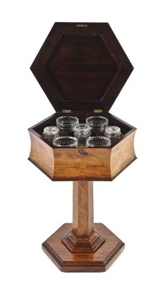 A Regency Rosewood Teapoy   Height 28 1/2 x width 19 3/4 x depth 17 inches   Palm Beach Winter Auction