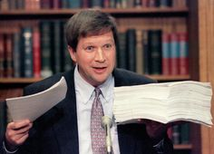 House Budget Chairman John Kasich (R-Oh) displays the Republican's budget plan (R) and President Clinton's budget proposal during a Capitol Hill news conference, November 16, 1995. (Photo: Reuters)