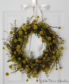 Fresh, fun and like nothing you have ever seen before. This charmingly beautiful greenery wreath is the ideal addition to your homes decor.  A