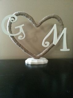 @Melissa Humphrey  Can WE make this???   Custom made to order Rustic Jute  Cake Topper by RusticWeddingsRUs, $22.00