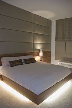 Bed appears to float over floor with rope lighting under the platform. Nice touch for lighting. Padded rear wall is nice