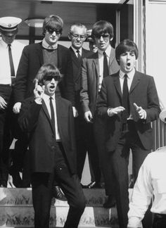John Lennon, George Harrison, Richard Starkey, and Paul McCartney (Paul's and Ringo's face omg)