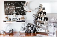 I like the black wire bowls/bins used to hold up the cake & donuts. The B&W theme is super unique and those swirl balloons totally win.