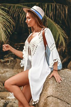 Complete your poolside look with the White Tie Front Cover Up with Tassels. This short cover up is detailed with crochet and a tassel trim for a bohemian-inspired look. Wear it open or tied at the front. Bikini Swimwear, Bikini Tops, Swimsuits, Bikinis, Bathing Suit Covers, Bathing Suits, Fall Is Coming, Tassels, Cruise