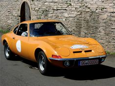 The Opel GT was built in Bochum, Germany from 1968 to 1973, and was first presented in 1965 at the Frankfurt Motor Show. The Opel GT had two engines available but the most powerful is the 1.9L Cam-In-Head four-cylinder engine that produces 102 horsepower @ 5400 rpm. This small engine was mated to a four-speed manual or three speed automatic transmission. Design was done by General Motors Stylist Claire MacKichan.