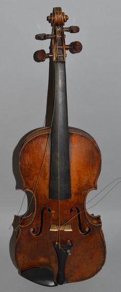 A one piece back violin bears label Casper Strad, Prague 1801, together with a bow signed Maline. Est. £250 – £500.