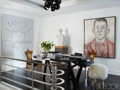 Joe Mimran NYC Home - Joe Fresh Owner Manhattan Duplex -Paintings by Thomas Zipp, left, and Hannah van Bart on the stair landing; the table is by Christopher Delcourt, the sculpture is by Volker Hüller, and the walls are painted in Farrow & Ball's Dimity.