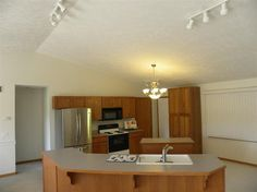 Kitchen with breakfast bar and heated tile floors!