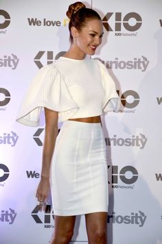 Candice Swanepoel in white crop top and high waisted pencil skirt at an event