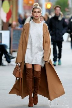 Hailey Baldwin's Over-the-Knee Boots and Cape in New York - Vogue