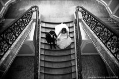 Bride and groom pose for wedding photos at the Four Seasons
