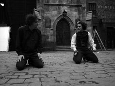 Tim Burton and Johnny Depp during the filming of Sweeney Todd in 2007