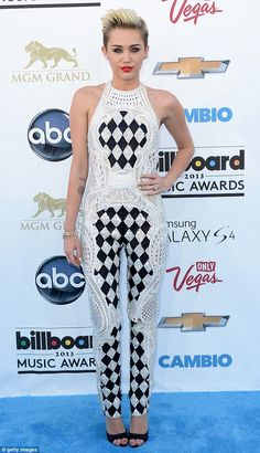 Miley Cyrus wears an over-the-top bejeweled crochet jumpsuit from Balmain to present at the 2013 Billboard Music Awards (May 2013)