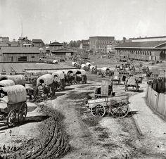 1864 WAGON TRAIN MOVING OUT OF ATLANTA, GEORGIA.