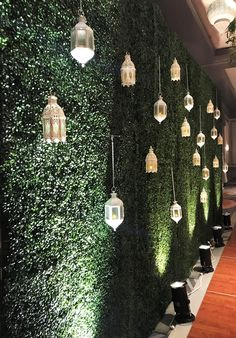 Lanterns against a boxwood wall create a soft, airy space! Lanterns against a boxwood wall create a soft, airy space! Wedding Stage Decorations, Engagement Decorations, Ramadan Decorations, Backdrop Decorations, Decoration Table, Wall Backdrops, Flower Wall Backdrop, House Plants Decor, Plant Decor