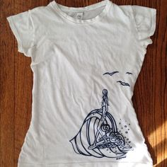 """Clearance ⭐️ Surfer Girl Tee Cute surf girl sheer short sleeved tee. Purchased from a boutique on the North Shore of Oahu. In great shape with one small area where I think there is discoloration (see 2nd pic), very faint so feels like my eyes are playing tricks! Can't be seen when wearing. 22"""" long, 100% cotton. Size says M but fits more like an S. ⭐️ prices on clearance items are non negotiable as they are already so cheap however bundle discount still applies! Boutique Tops Tees - Short…"""