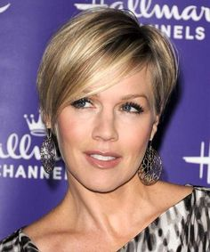 *This is my latest inspiration for my own do...it's quite a bit shorter though.  If you do this one, insist on the longer bangs that sweep to the side like hers - it grows out a bit nicer that way!*