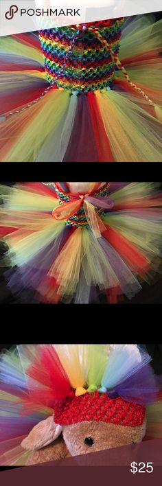 Rainbow  baby  Tutu Dress  This beautiful dress is a Handmade Rainbow  baby  Tutu Dress. This dress has Ref, Yellow, Green, Blue and Purple. Has 2 double layers of tulle. The bottom layer is about 10 inches long, the top layer is about 8 inches long. This dress with fit from 0-12 Months. The top will stretch to about a 20 inch circumference (the paper towel roll is 18 inches.) Comes with a handmade matching headband too. A & K Pretties Dresses